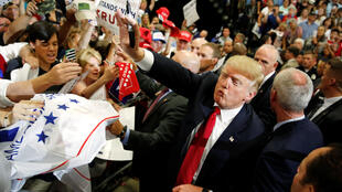 Republican U.S. presidential candidate Donald Trump blows a kiss as he signs autographs after a rally with supporters in Albuquerque, New Mexico, U.S. May 24, 2016. REUTERS/Jonathan Ernst