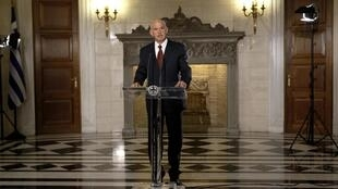 Greece's PM George Papandreou delivers a speech in a televised address to the nation