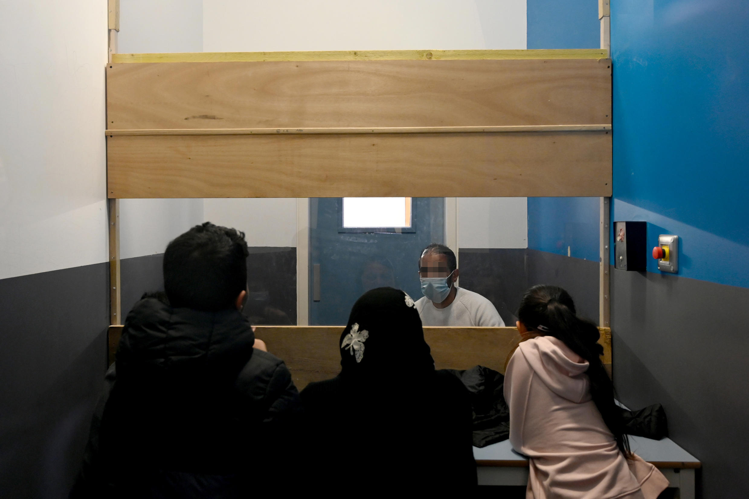Separated by a window, children visit their father at a Marseille prison for 45 minutes