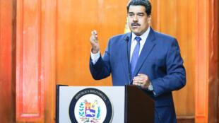 L'opposition ne reconnaît pas le Conseil national électoral qui doit superviser ce scrutin, dont les recteurs ont été nommés par une institution acquise au président Maduro (photo).