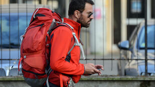 Jérôme Kerviel walks in Modena, Italy, as part of his pilgrimage from Rome to Paris