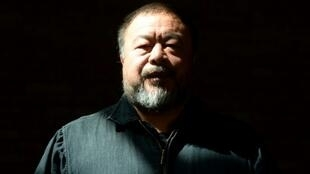 "Chinese dissident and internatioanlly renowned artist Ai Weiwei, pictured in April 2014, says he feels that people pushed away from their home ""are part of me and I am part of them"""
