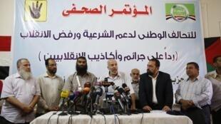 Chama cha Muslim Bradherhood kikiendesha mkutano na vyombo vya habari jijini Cairo baada ya kukamatwa kwa kiongozi wake Agosti 20 le 20 août 2013.