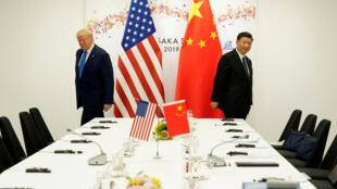 资料图片:中美紧张关系使得亚太国家担心经济危机走向军事冲突。摄于2019年6月29日中国国家主席习近平与美国总统特朗普在日本大阪20国集团峰会期间的会晤。