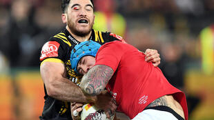 British and Irish Lions player Jack Nowell is tackled by Nehe Milner-Skudder of the Wellington Hurricanes, Wellington, New Zealand - June 27, 2017