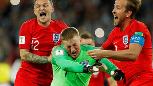 England's Jordan Pickford celebrates after saving Colombia's Carlos Bacca penalty during the shootout with team mates on 3 July 2018.