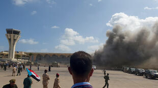 Smoke billows at Aden Airport in southern Yemen on December 30, 2020, following explosions shortly after the arrival of a plane carrying cabinet ministers