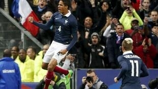 Raphael Varane celebrates his goal against Brazil at the Stade de France, 26 March 2015