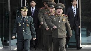 North Korean Colonel Ri Son-kwon (front R) and other North Korean officers before the 8 February meeting