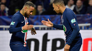 Neymar (left) and Kylian Mbappé scored three of PSG nine goals in their 9-0 waltz past second division Le Havre.