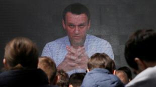 Apoiadores de Alexei Navalny, opositor do presidente russo Vladimir Putin, se reuniram em várias cidades do país, para dar suporte a sua possível candidatura presidencial, em 24 de dezembro de 2017.