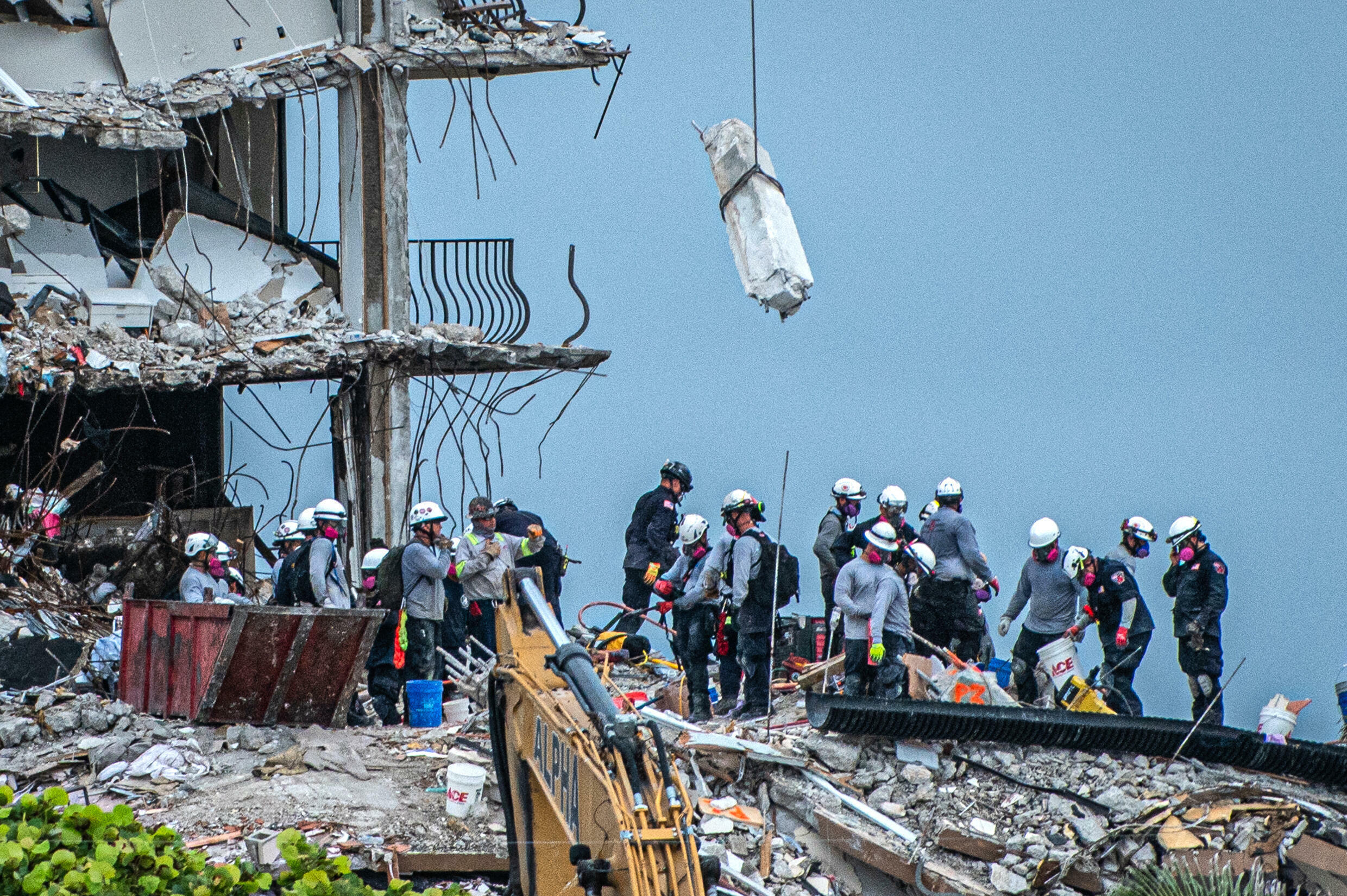 Search and Rescue teams look for survivors in the partially collapsed 12-story Champlain Towers South condo building on June 30, 2021 in Surfside, Florida