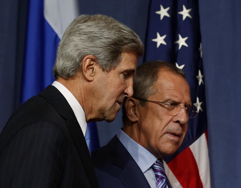 Сергей Лавров и Джон Керри в ходе совместной пресс-конференции в Женеве,12 сентября 2013