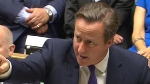 Le Premier ministre britannique David Cameron devant le Parlement lors du vote, le 26 septembre 2014 à Londres.