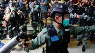 2020-06-12T125629Z_1557920933_RC2O7H9JJSKA_RTRMADP_3_HONGKONG-PROTESTS