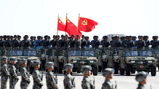 Soldiers of China's People's Liberation Army (PLA) march during a military parade to commemorate the 90th anniversary of the foundation of the army at the Zhurihe military training base in Inner Mongolia Autonomous Region, China July 30, 2017.