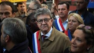 France's leftist party La France Insoumise (LFI) president Jean-Luc Melenchon (C) looks on as he arrives at the courthouse in Bobigny on September 19, 2019
