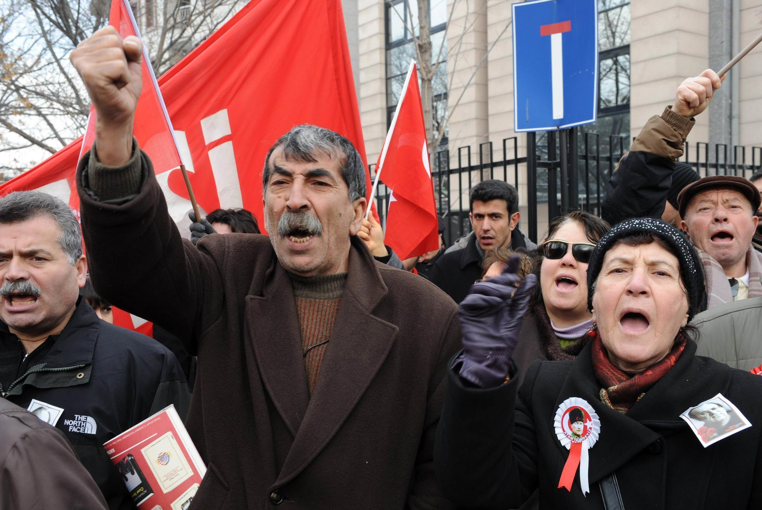 Members of the left-wing Workers' Party shout slogans as they gather to protest France in front of the French embassy in Ankara
