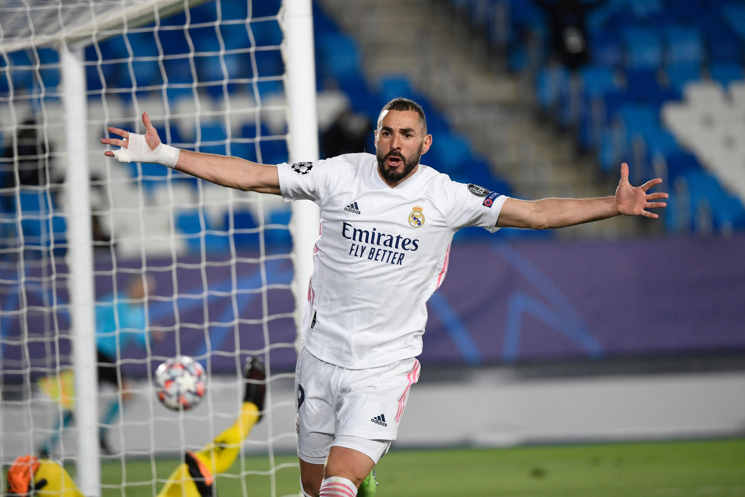 Karim Benzema's brace sent record 13-time winners Real Madrid through to the last 16 of the Champions League