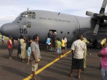 New Zealand air force air craft distribute aid