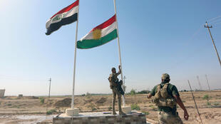 A member of Iraqi security forces takes down the Kurdish flag in Kirkuk, Iraq October 16, 2017.