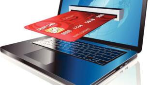 Une carte de crédit et un ordinateur, symboles du e-commerce.