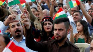 Des manifestants défilent pour montrer leur soutien au référendum sur l'indépendance du Kurdistan, le 16 août 2017 à Kirkouk.