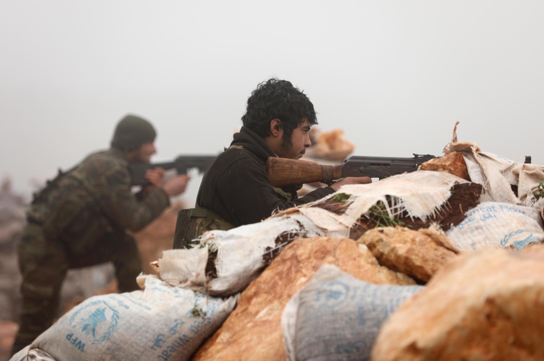 Dans l'enclave d'Afrin, en Syrie, le 24 janvier: milicien syrien participant à l'opération «Rameau d'olivier» lancée le 20 janvier avec le soutien de la Turquie