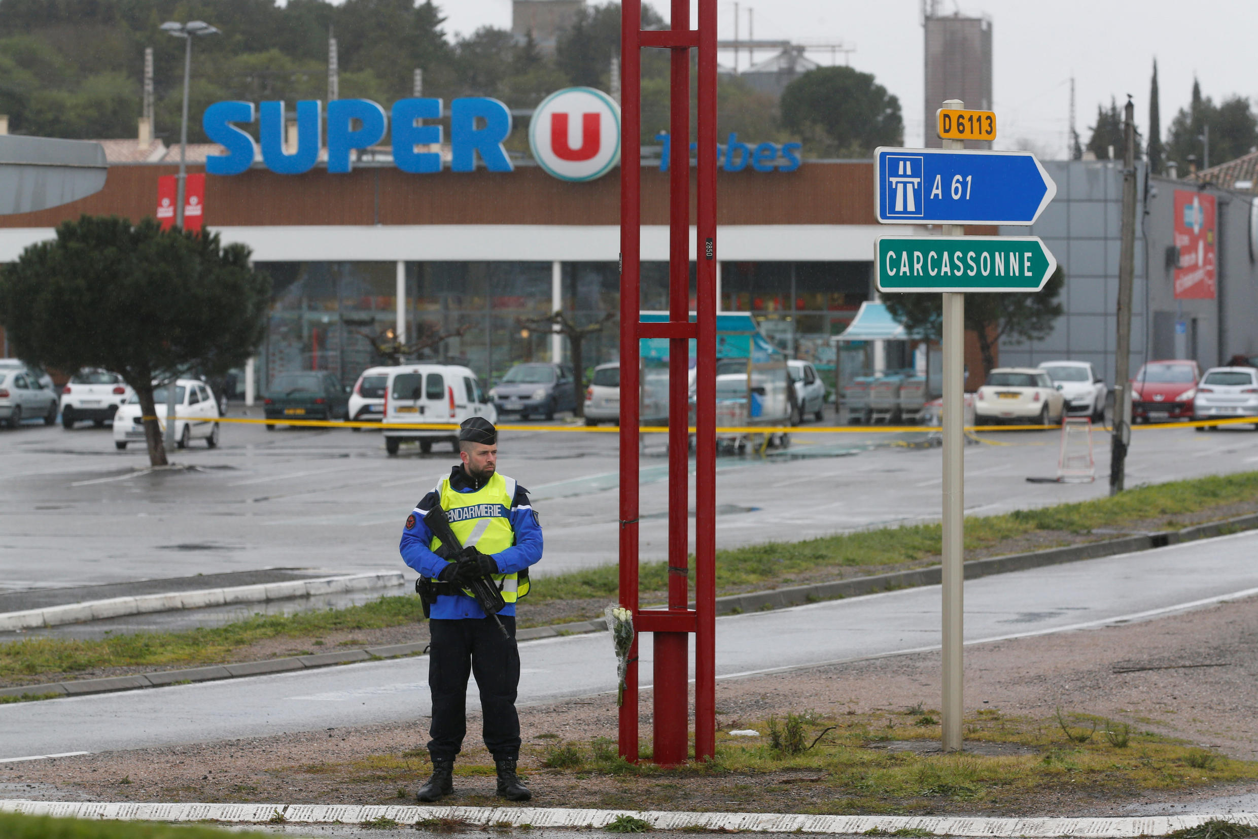 A French gendarme secures the access to a supermarket after a hostage situation in Trèbes on 24 March, 2018.