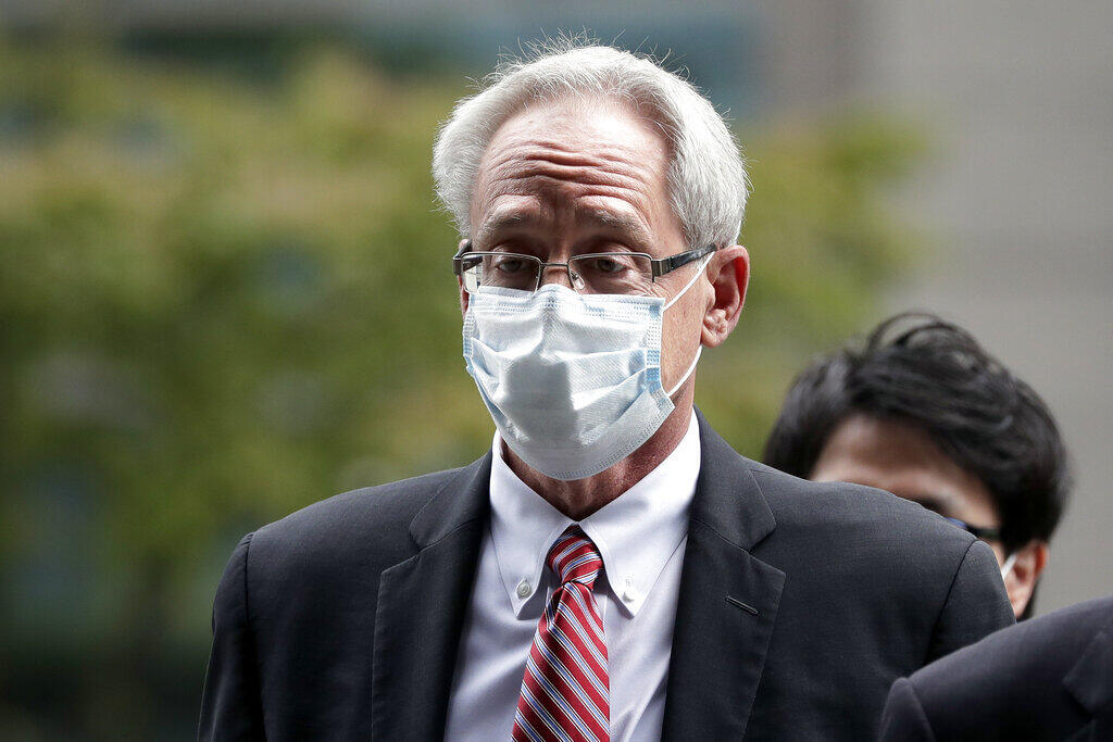 Former Nissan executive Greg Kelly arrives for the first trial hearing at the Tokyo District Court on Tuesday.