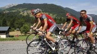 Radioshack rider Lance Armstrong of the US cycles with team-mates during a training session