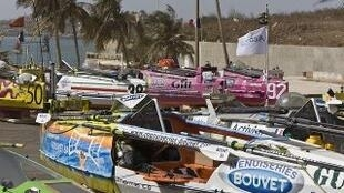 The armada of rowing boats is waiting before the start of the race on N'Gor beach in Dakar