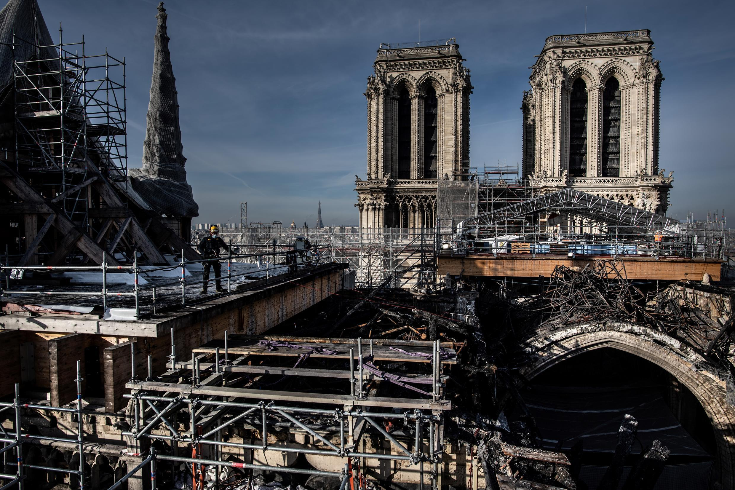 The first task for workers on Notre-Dame cathedral has been removing hundreds of tonnes of scaffolding that were damaged in the fire