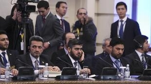 Mohammad Alloush (C), the head of the Syrian opposition delegation, at Syria peace talks in Astana, Kazakhstan on 23 January