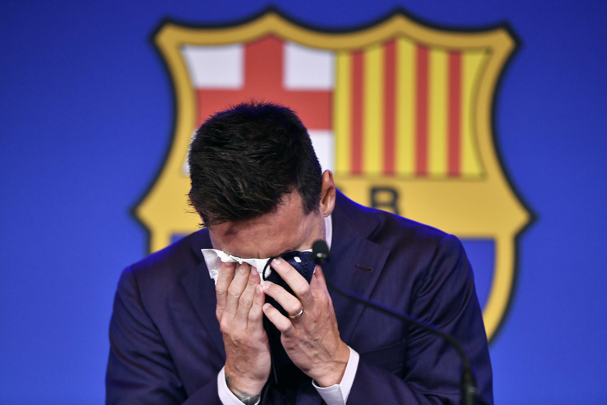 A emotional Messi struggles to compose himself before addressing reporters on his departure from Barcelona after 17 years playing for his only club