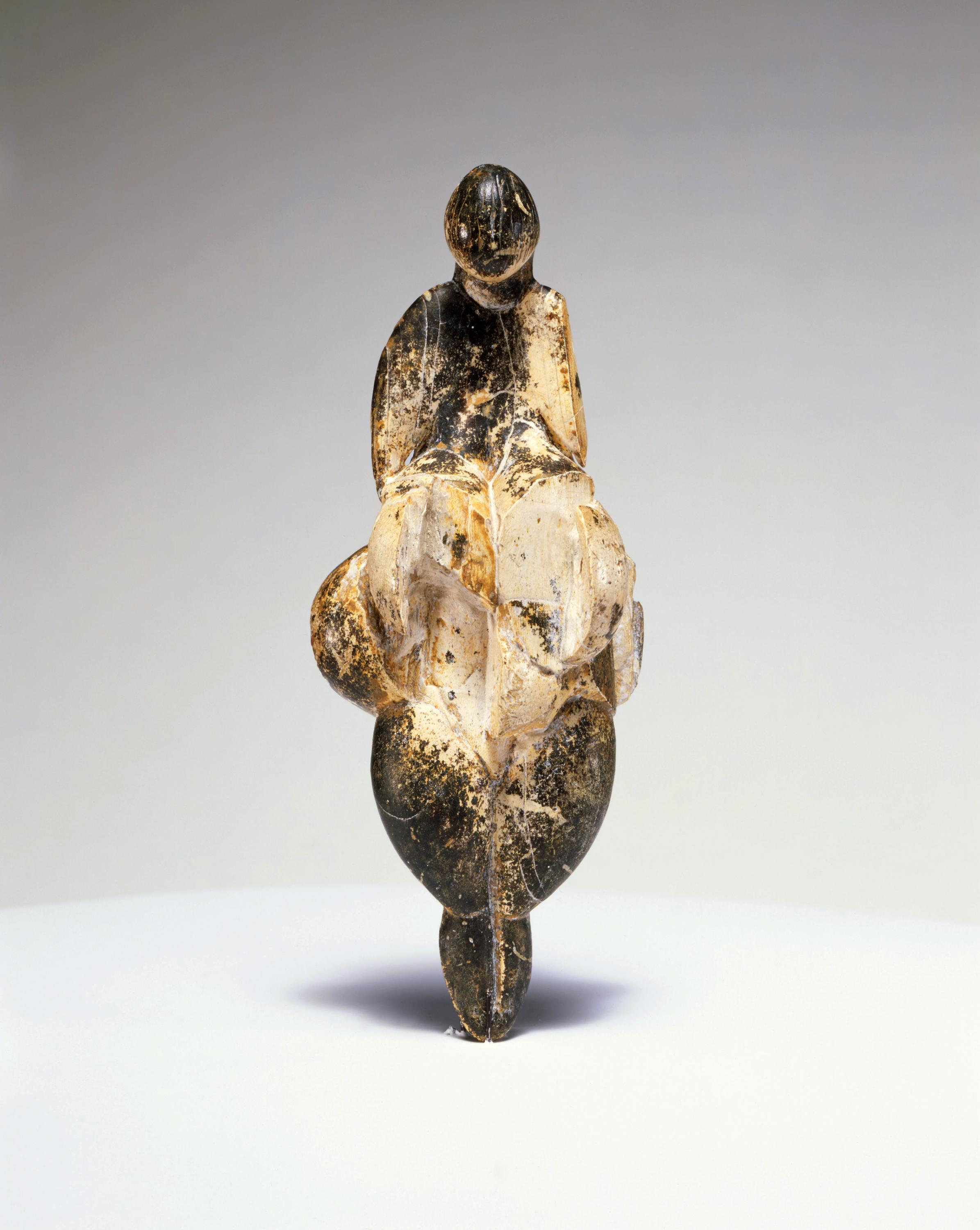 The venus of Lespugue, a statuette carved from mammoth ivory some 23,000 years ago, was found in the Rideaux cave in southern France in 1922. It appears in the exhibit courtesy of the Musée de l'Homme in Paris.