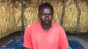 Oumar Saleh, refugee in Chad originally from Bossangoa, CAR, worries about his 6 children getting bitten by snakes