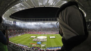 A spectator watches a match at the Ahmad bin Ali stadium in Qatar which will host Club World Cup fixtures