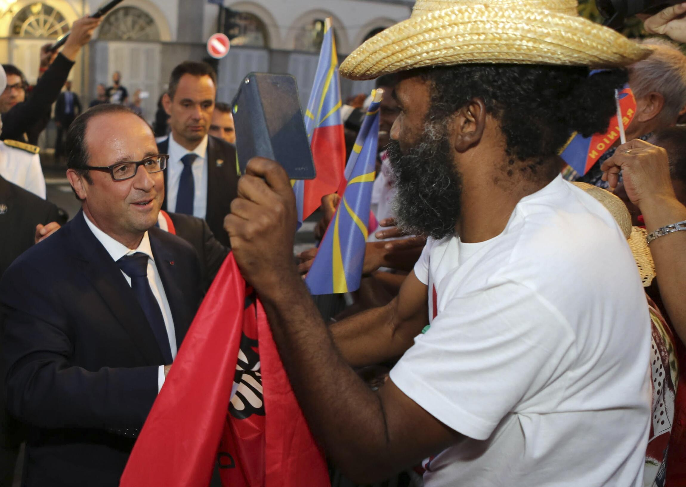 French President François Hollande on a three-day visit to the Indian Ocean.
