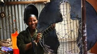 Safina Kimbikota akifanya Ubunifu katika karakana yake jijini Dar es salaam