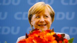 Thành tích kinh tế giúp Angela Merkel giữ được chiếc ghế thủ tướng 4 nhiệm kỳ.