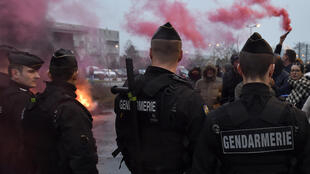 Gendarmes clear the access during a demonstration of prison officers on January 25, 2018 in front of the Nancy-Maxéville prison as part of a nationwide movement to call for better safety and wages