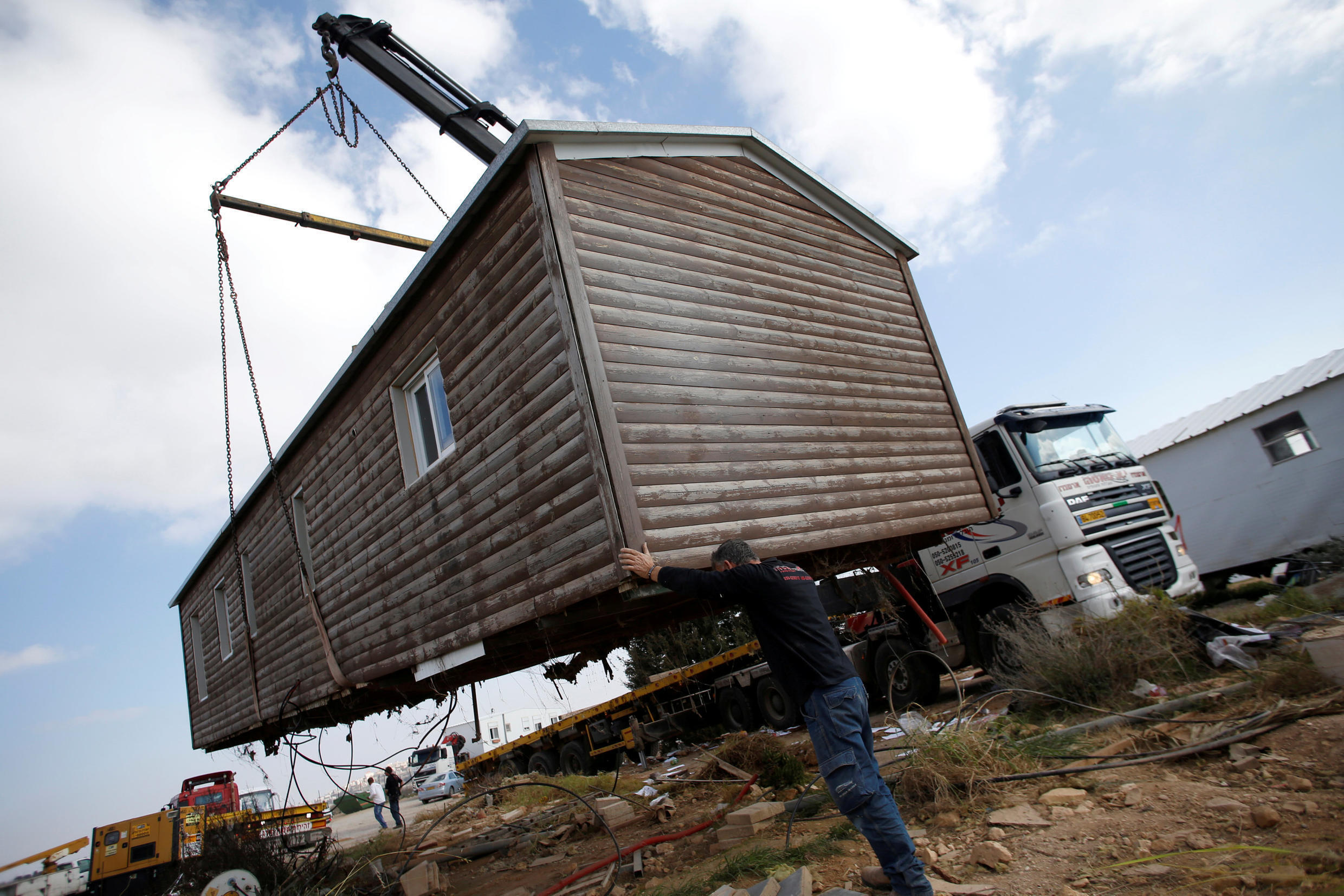 Experts say the new law is seen as compensation to the settlers in view of the evacuations in Amona and Ofra.