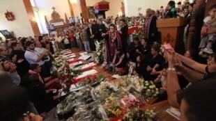 Отпевание жертв атаки Аль-Каиды в церкви Богоматери Спасения в Багдаде