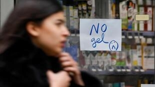 """A """"No gel"""" sign is seen in the windows of a pharmacy in France, as people rushed to buy disinfectant hand gel"""