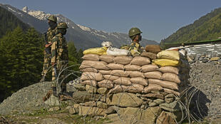Indian Border Security Force soldiers guard a highway leading towards Leh, bordering China, in Gagangir on 17 June 2020.