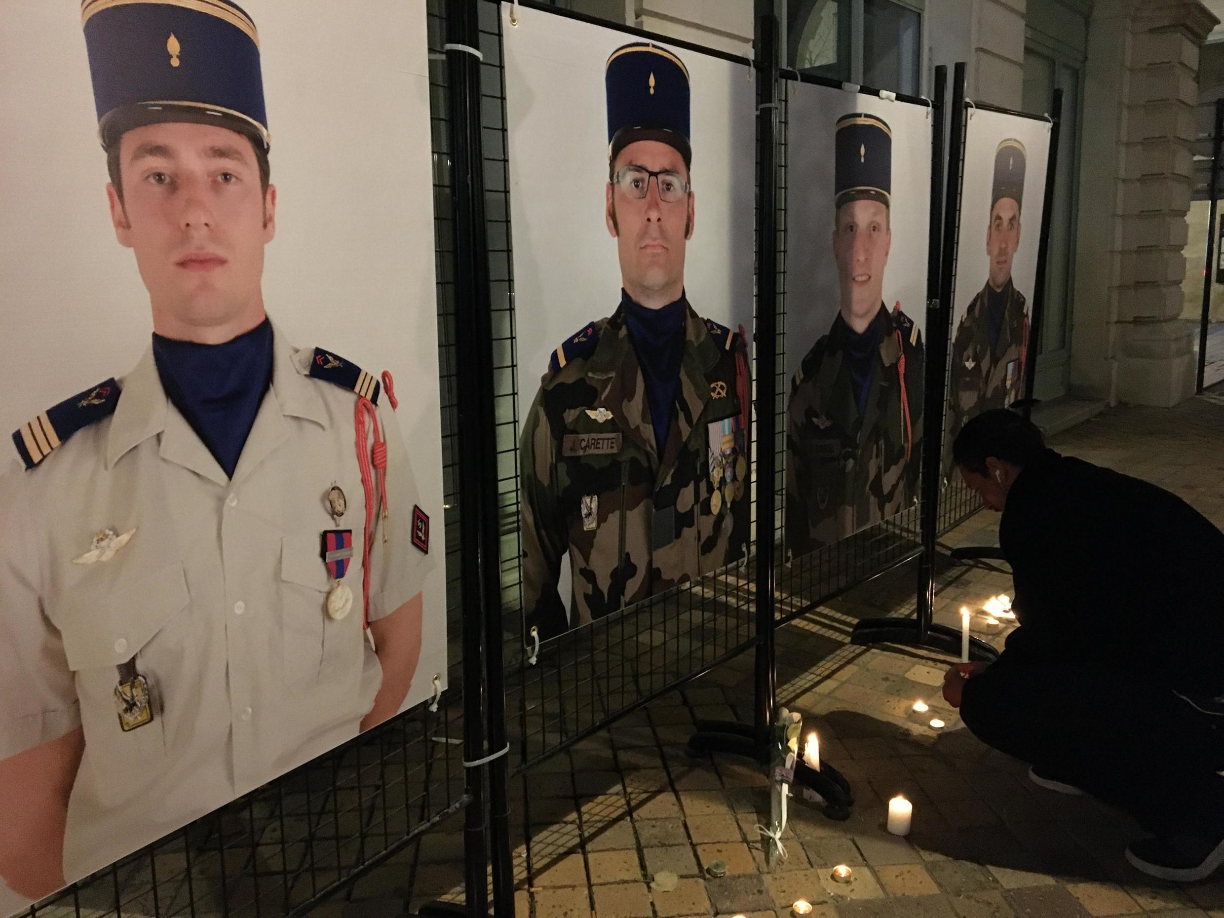 Portraits of soldiers who died were displayed in Pau, where a tribute was held. Seven of the men were from a helicopter unit based in Pau. 26 November 2019