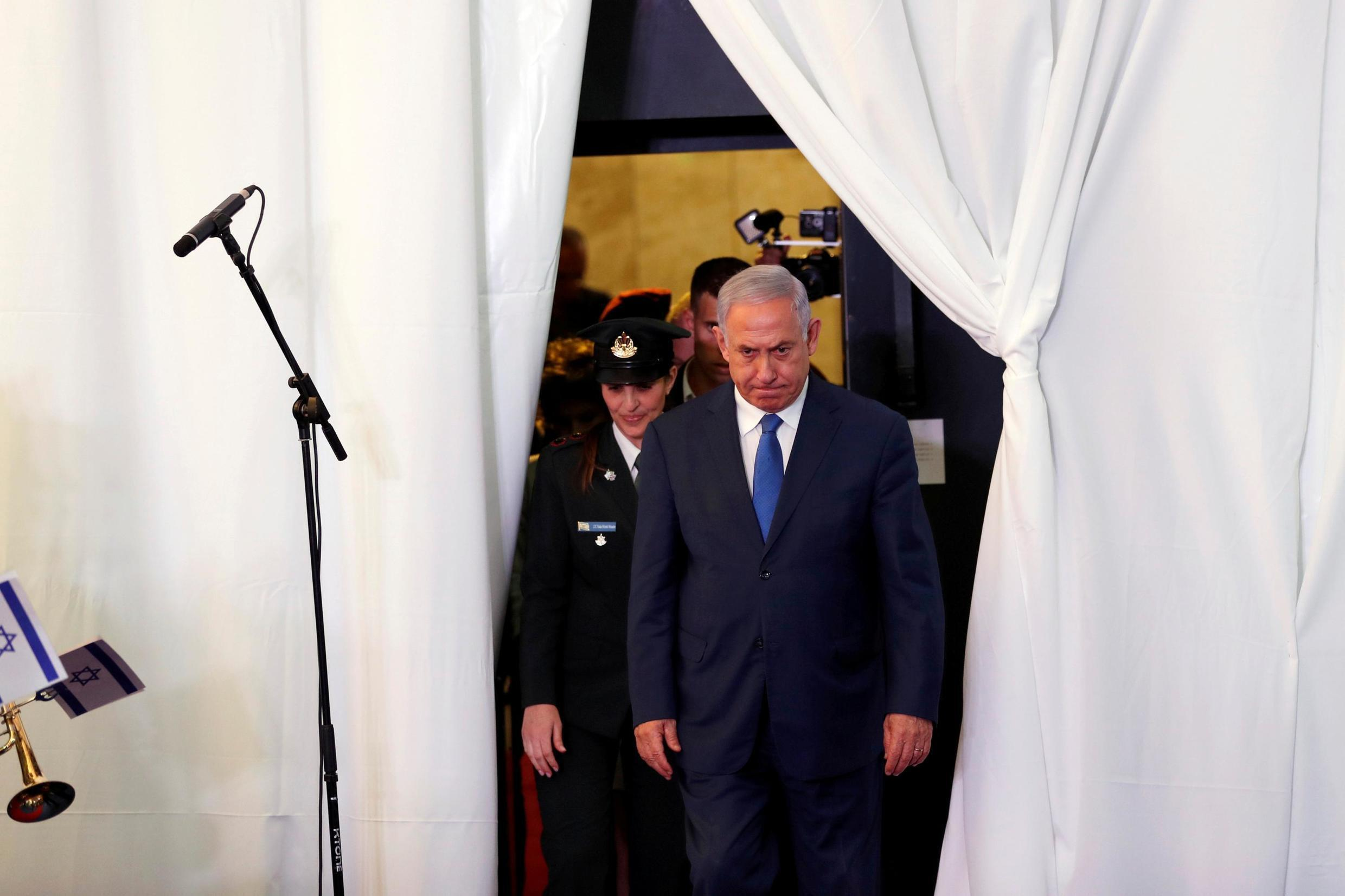 FILE PHOTO: Israeli Prime Minister Benjamin Netanyahu looks on as he arrives to review an honor guard with his Ethiopian counterpart Abiy Ahmed during their meeting in Jerusalem September 1, 2019