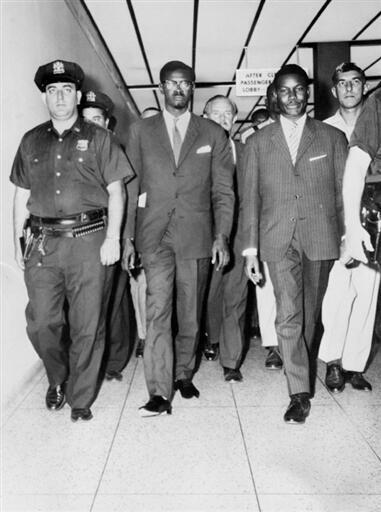 Patrice Lumumba with US police at Idlewild Airport, New York, on 24  July 1960
