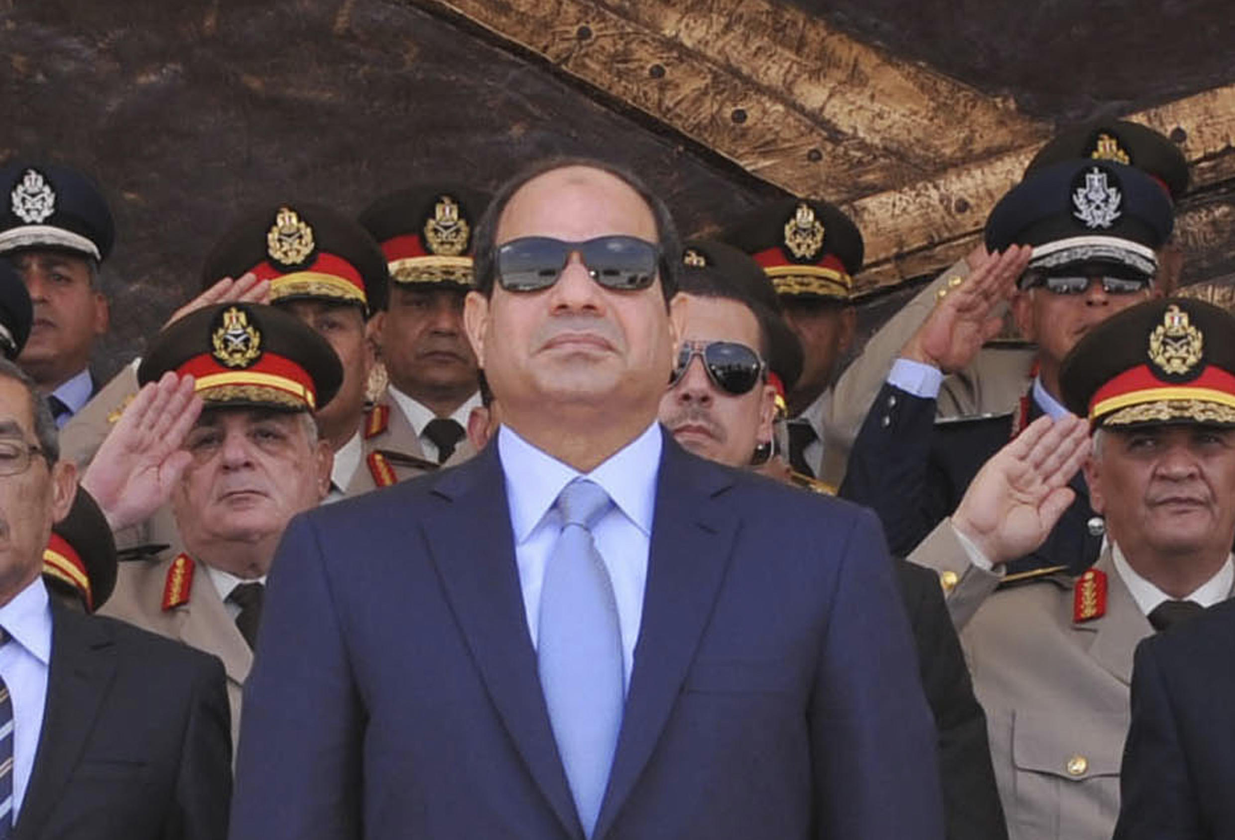 President Abdel Fattah al-Sissi surrounded by his generals